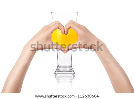 Glass of beer with the heart  made of two women hands. love beer concept - stock photo