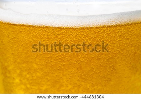 glass of beer with white background. Beer with bubbles close up