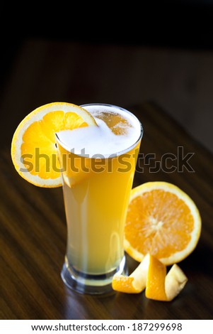 Glass of Belgium Wheat Ale with an orange slice - stock photo