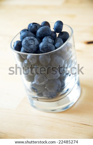 Glass of blueberries