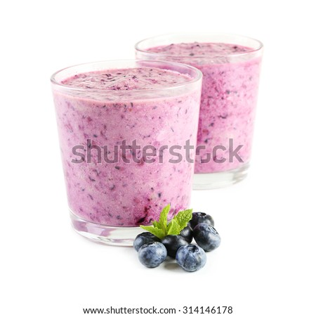 Glass of blueberry smoothie, closeup - stock photo
