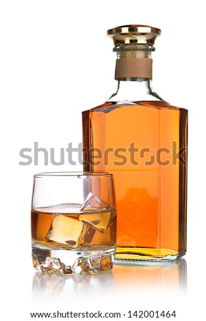 Glass of brandy and bottle isolated on white - stock photo