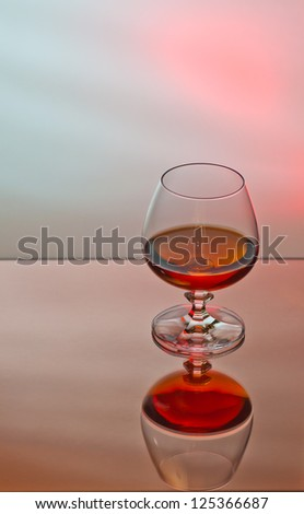 glass of brandy on moody background
