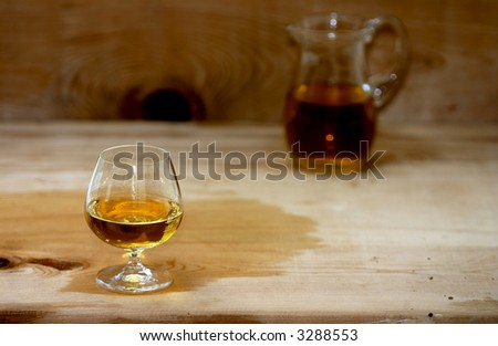Glass of brandy over wood