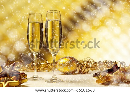Glass of champagne against golden background - stock photo