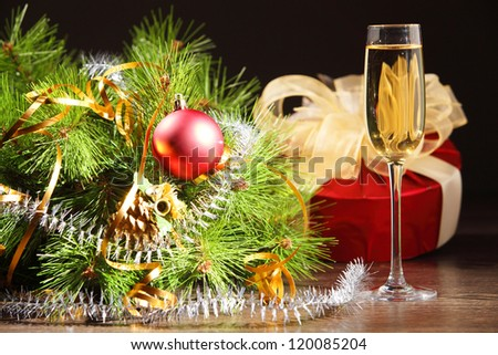 glass of champagne and christmas decoration on the tavle for a new year eve - stock photo