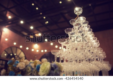 Glass of champagne for event party or wedding ceremony - stock photo