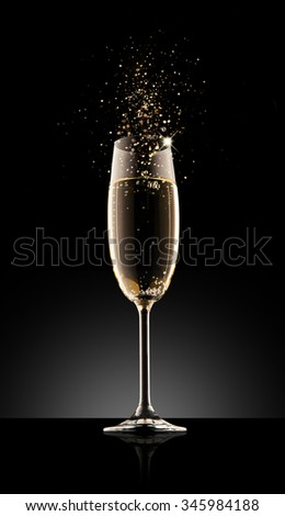 Glass of champagne, isolated on a black background. - stock photo