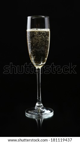 Glass of champagne, on black background