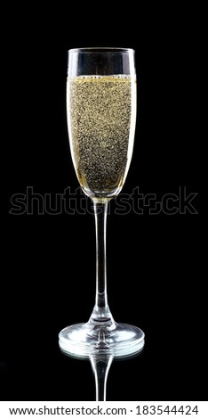 Glass of champagne, on black background - stock photo