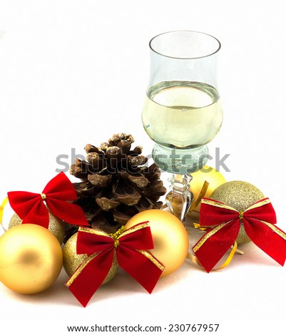 glass of champagne with Christmas decorations on a white background