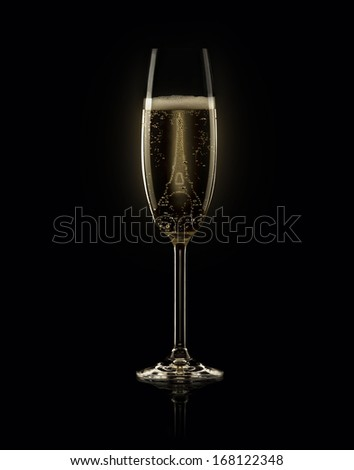 Glass of champagne with Eiffel Tower on black background