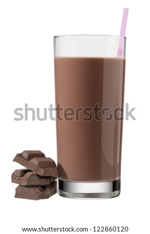 Glass of chocolate drink with straw beside three chocolate chunks - stock photo