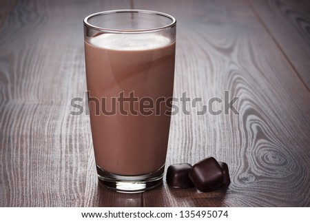 glass of chocolate milkshake on the table - stock photo