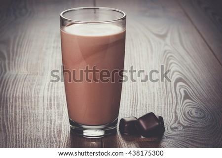 glass of chocolate milkshake on the table - stock photo