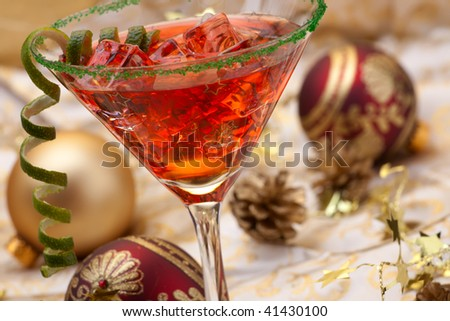 Glass of Christmas Cocktail in martini glass and Christmas ornaments - stock photo