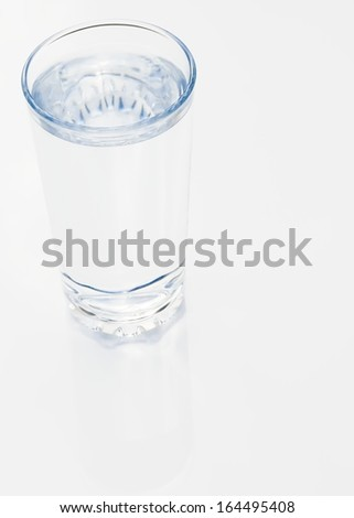 Glass of clear refreshing water on a white background - stock photo