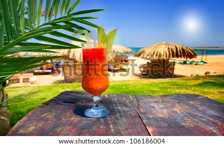 Glass of cocktail on the rusty table. - stock photo