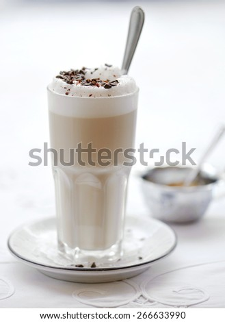 Glass of cocoa with foam - stock photo