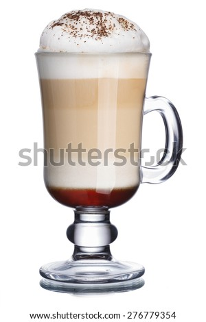 Glass of coffee cocktail with foam decorated with cinnamon powder