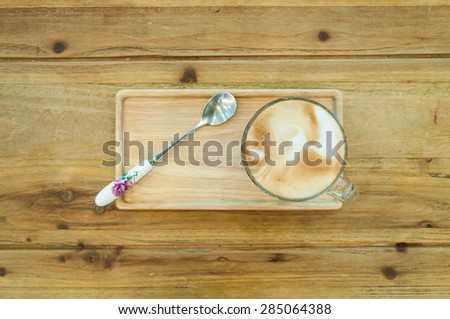 Glass of coffee on the wood table, top view - stock photo