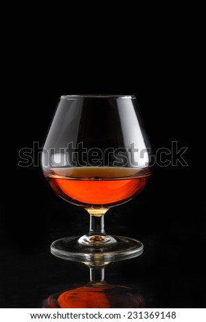 Glass of cognac with copy space - stock photo