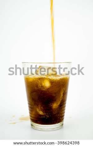 Glass of Coke (Cola) with ice cubes on white background - stock photo