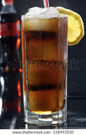 Glass of cola drink - stock photo
