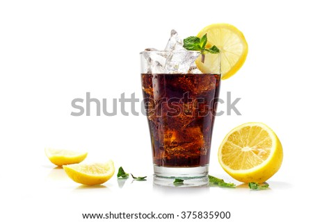 glass of cola, ice tea or coke with ice cubes, slices of lemon and peppermint garnish, isolated on white - stock photo
