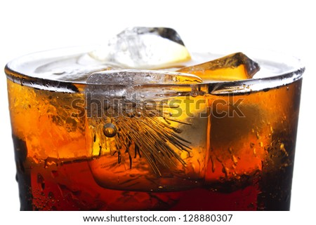 Glass of cola isolated on ice