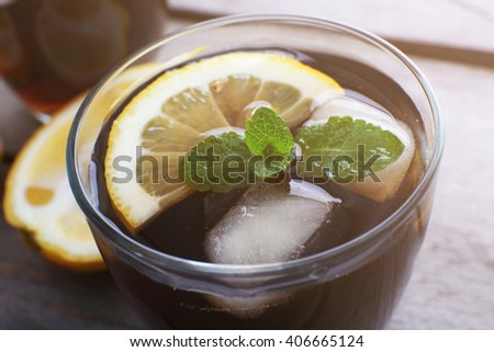 Glass of cola with ice, close up