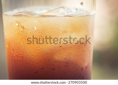 glass of cola with ice cubes. - stock photo
