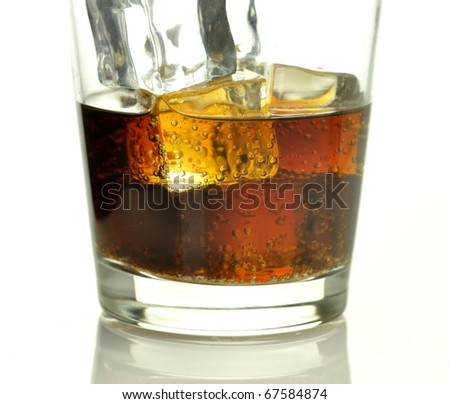 glass of cola with ice cubes  close up