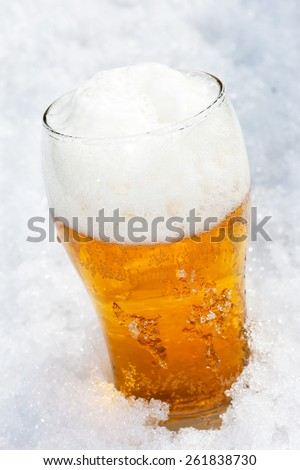 Glass of cold beer with foam
