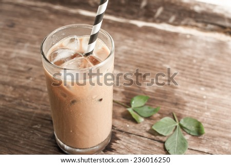 Glass Of Cold Coffee On Wood - stock photo