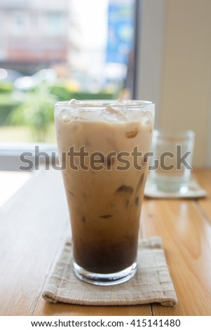 Glass Of Cold Coffee On Wood. - stock photo