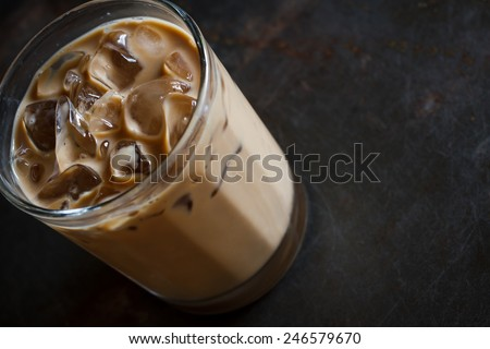 Glass of Cold Iced Coffee put on grunge table - stock photo