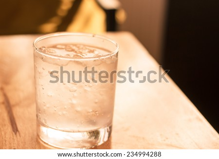 glass of cold water on table - stock photo