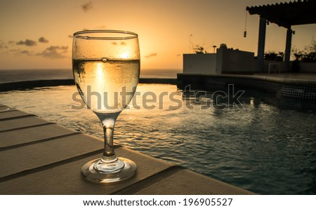 Glass of cold white wine in the Cariibean sunset of Curacao