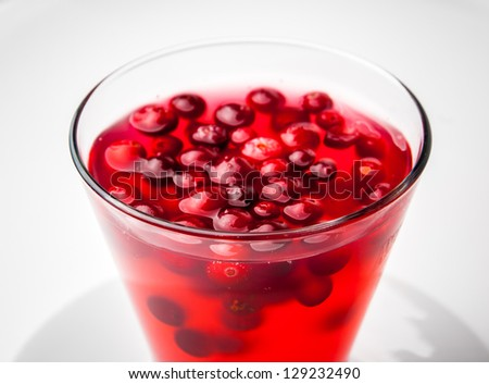 Glass of cranberry compote on white Dish - stock photo