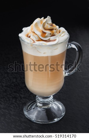 glass of cup coffee with cream on black table