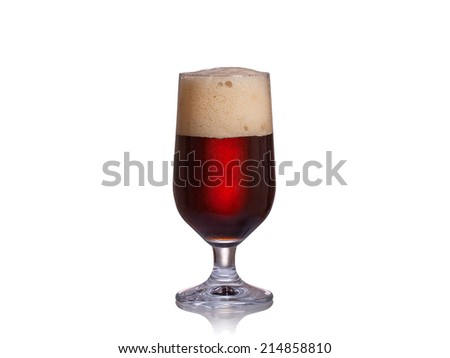 Glass of dark beer isolated on a white background - stock photo