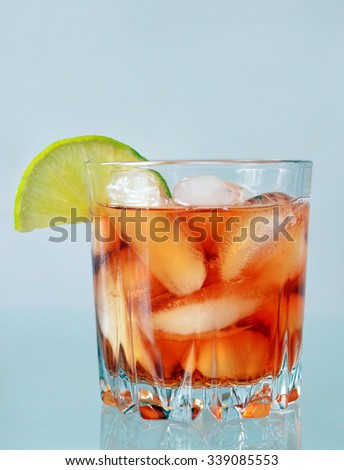 Glass of drink with lime