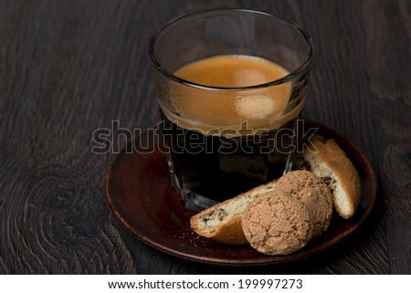 glass of espresso, biscotti and almond cookies, close-up