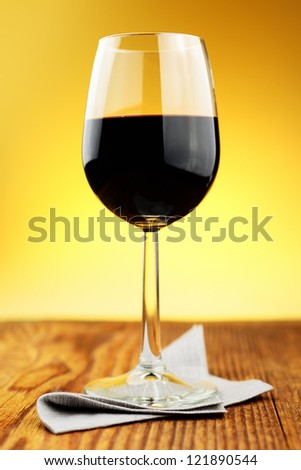 Glass of fine italian red wine on a old wooden table - stock photo