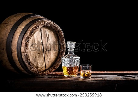 Glass of fine whisky in the distillery basement - stock photo