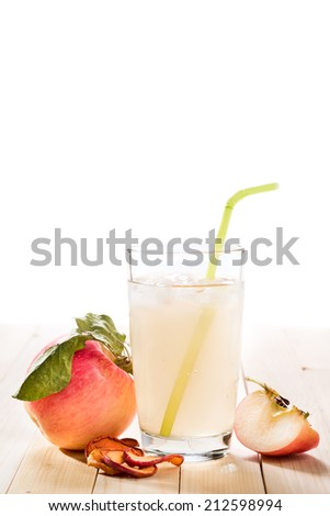 Glass of fresh apple compote. background