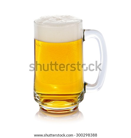 Glass of fresh beer isolated on white background. - stock photo