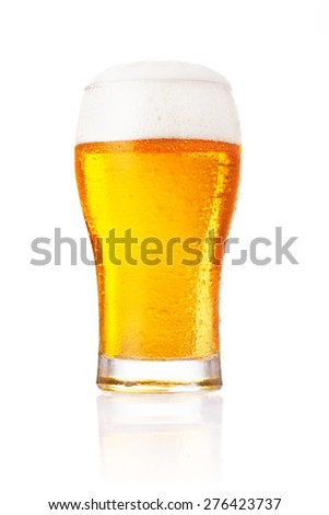 Glass of fresh beer with cap of foam isolated on white background.