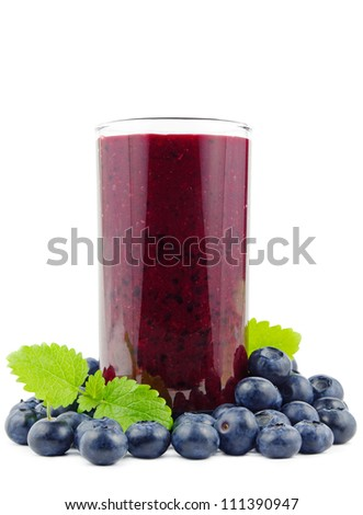 Glass of fresh blueberry smoothie with blueberries on white